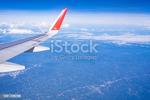 istock Beautiful view from airplane window and blue sky on nice sunny day, This time in altitude during flight. 1061208296