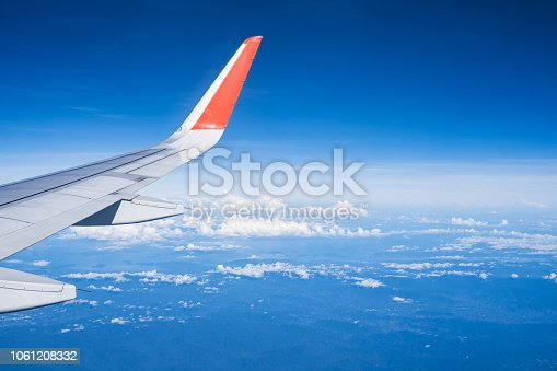 istock Beautiful view from airplane window and blue sky on nice sunny day, This time in altitude during flight. 1061208332