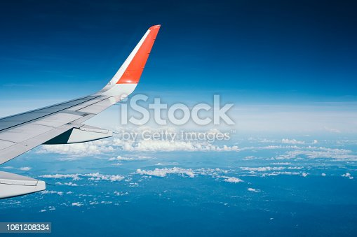 istock Beautiful view from airplane window and blue sky on nice sunny day, This time in altitude during flight. 1061208334