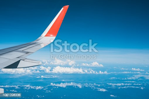 istock Beautiful view from airplane window and blue sky on nice sunny day, This time in altitude during flight. 1061208336