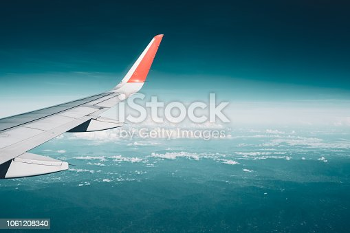 istock Beautiful view from airplane window and blue sky on nice sunny day, This time in altitude during flight. 1061208340