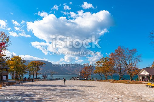 Beautiful view from Lake Towada lakeside pier, clear sky, blue water, white cloud in sunny day during autumn foliage season. Towada hachimantai National Park, Aomori Prefecture, Japan - Oct 25, 2018