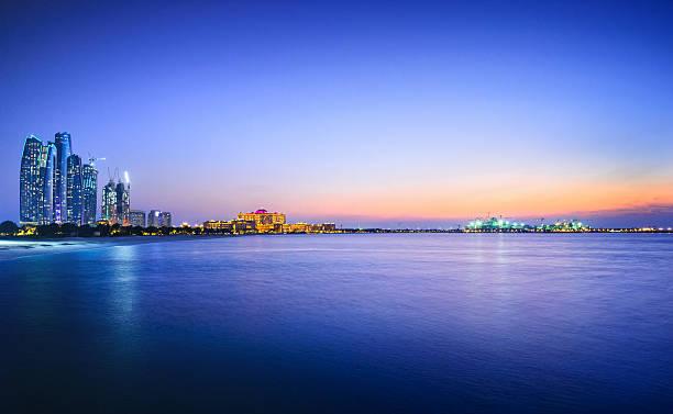 beautiful view of a city and water in abu dhabi - abu dhabi stok fotoğraflar ve resimler