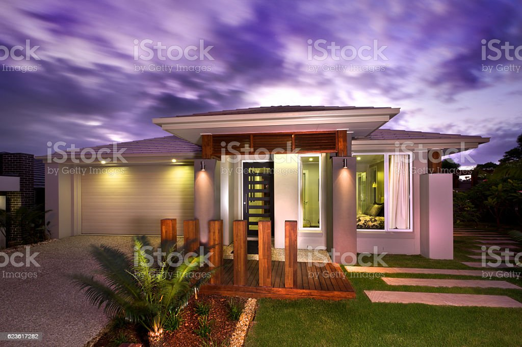 Beautiful view of a home from front with a garage stock photo