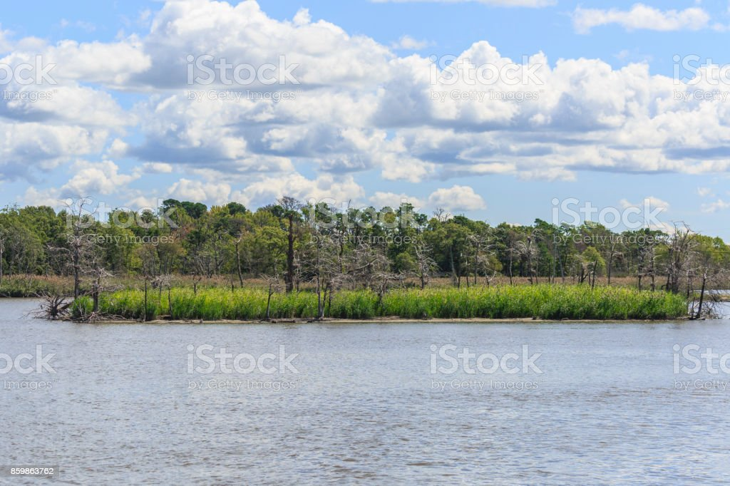 Beautiful View of a Lake, and Island with a Cloud Filled Sky Above stock photo