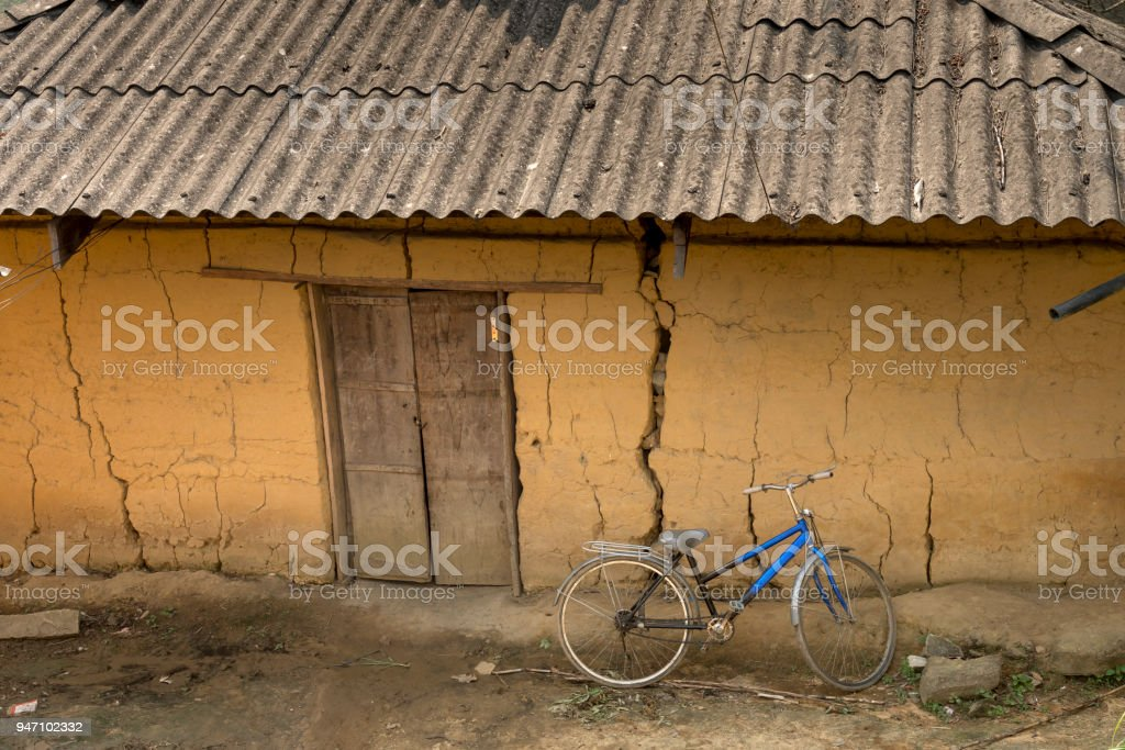 Beautiful view of a small house of ethnic minority people there is wall made of clay in the Ha Giang rocky plateau, Vietnam stock photo