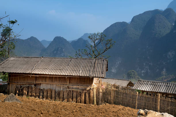 beautiful view of a small village of ethnic minority people in the ha giang rocky plateau, vietnam - minority stock photos and pictures