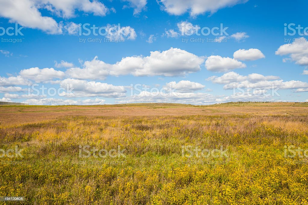 Beautiful View of Autumn Field and Cloud Filled Sky stock photo