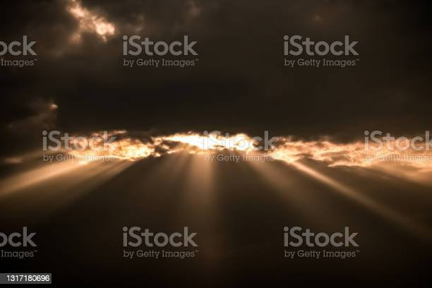 Photo of Beautiful view of beams of sunlight coming through the clouds.