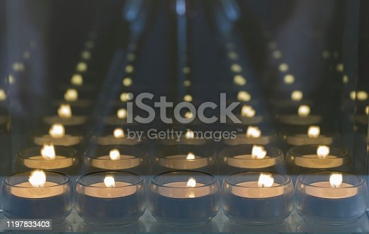Beautiful view of candlelights with mirror reflection. Holidays romantic concept.
