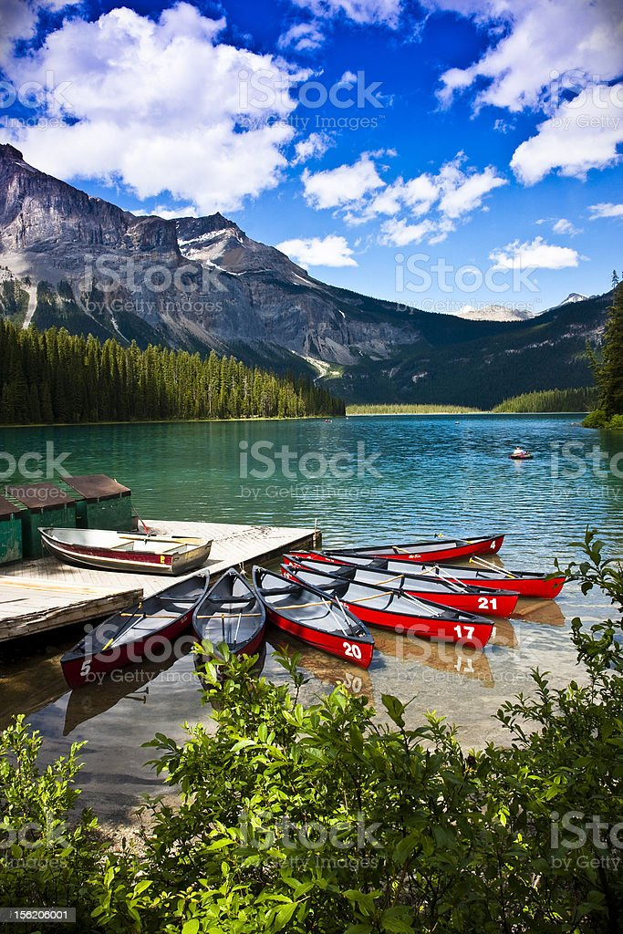 A beautiful view of canoes on Emerald Lake stock photo