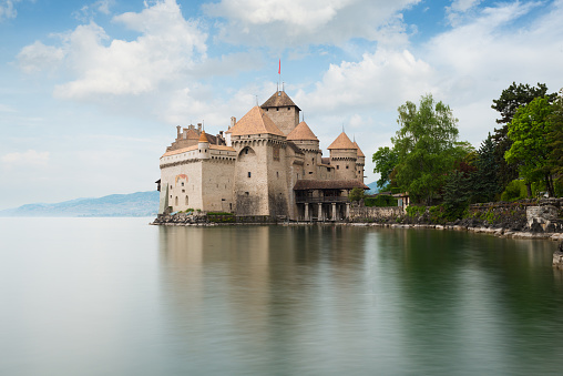 Geneva, Switzerland - May 9, 2016 : Beautiful view of famous Chateau de Chillon at Lake Geneva, one of Switzerland's major tourist attractions and most visited castles in Europe, Canton of Montreux, Switzerland.