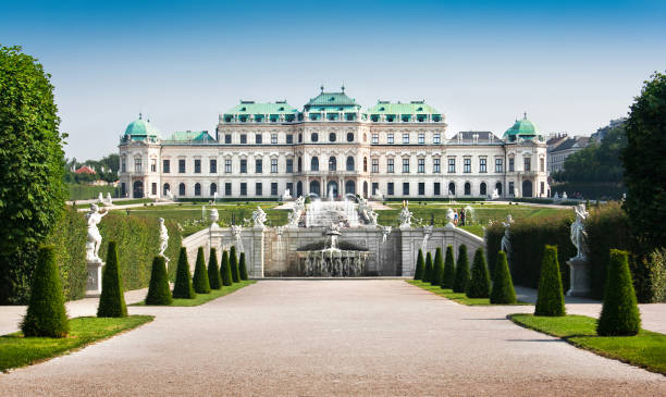 beautiful view of famous schloss belvedere, built by johann lukas von hildebrandt as a summer residence for prince eugene of savoy, in vienna, austria - vienna stock photos and pictures