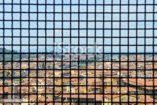 Beautiful view of Florence through grid from Palazzo Vecchio in Florence, Italy