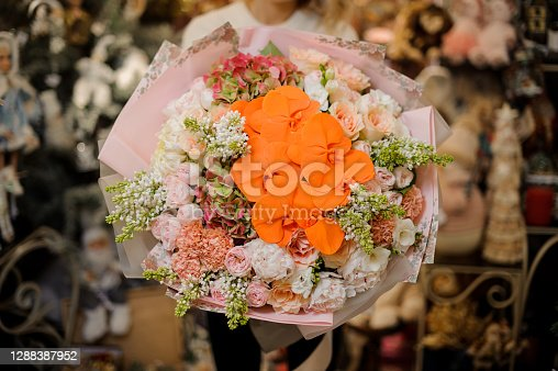 beautiful view of flowers of large charming bouquet of bright orange orchids and other flowers of white and pink colors
