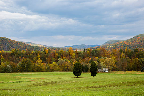 Beautiful View of Green Meadow, Rolling Hills and Autumn Colors stock photo