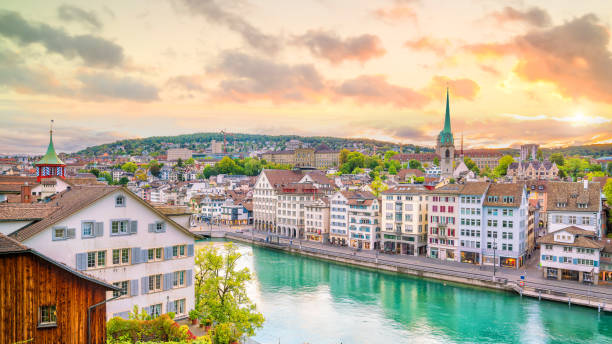 Beautiful view of historic city center of Zurich at sunset Beautiful view of historic city center of Zurich at sunset in Switzerland limmat river stock pictures, royalty-free photos & images