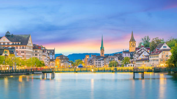 Beautiful view of historic city center of Zurich at sunset Beautiful view of historic city center of Zurich at sunset in Switzerland fraumunster stock pictures, royalty-free photos & images