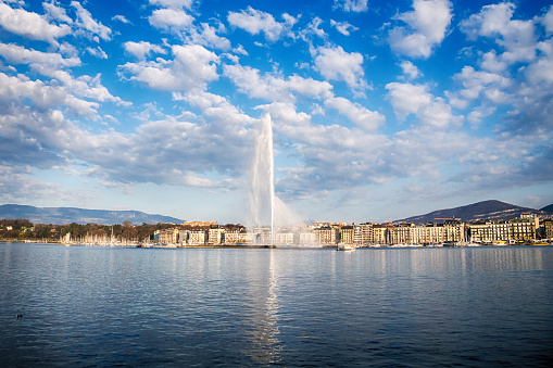 Beautiful View of historic Geneva skyline with famous Jet d'Eau fountain at harbor district in beautiful of Geneva, Switzerland