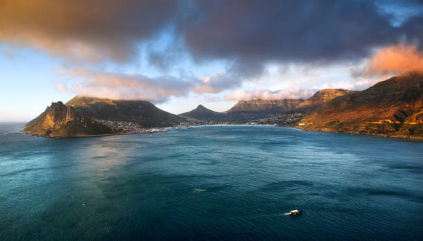 Beautiful view of Hout Bay and mountains from Chapmans Peak Drive Beautiful view of Hout Bay and mountains from Chapmans Peak Drive at sunset hout stock pictures, royalty-free photos & images