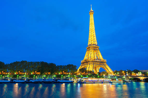 beautiful view of illuminate light eiffel tower - eiffelturm stock-fotos und bilder