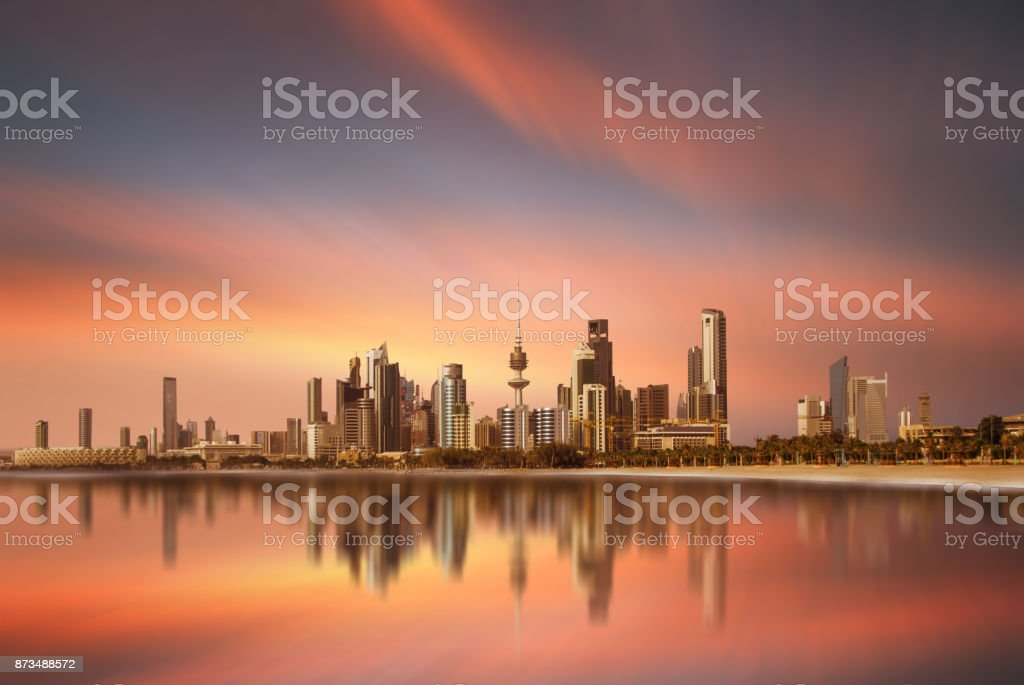 Beautiful view of kuwait city skyline with reflection during sunset stock photo