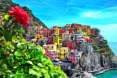istock Beautiful view of Manarola town. Is one of five famous colorful villages of Cinque Terre National Park in Italy, suspended between sea and land on sheer cliffs. Liguria region of Italy. 935366070