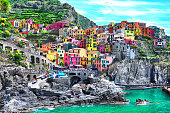 istock Beautiful view of Manarola town. Is one of five famous colorful villages of Cinque Terre National Park in Italy, suspended between sea and land on sheer cliffs. Liguria region of Italy. 935372664