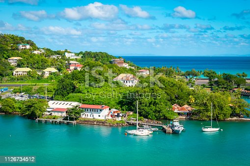 Colorful image of Castries, cruise harbor of Saint Lucia in the Caribbean. Sea, buildings at the port and blue sky on a beautiful summer day.