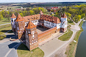 MINSK, BELARUS - APRIL 26, 2020: Beautiful view of medieval Mir castle on sunny spring day. UNESCO World Heritage Site. Aerial view from the drone.
