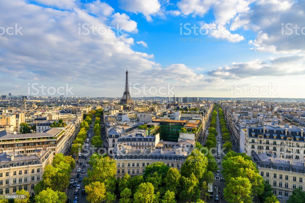 Beautiful view of Paris from the roof of the Triumphal Arch. Champs Elysees and the Eiffel Tower stock photo