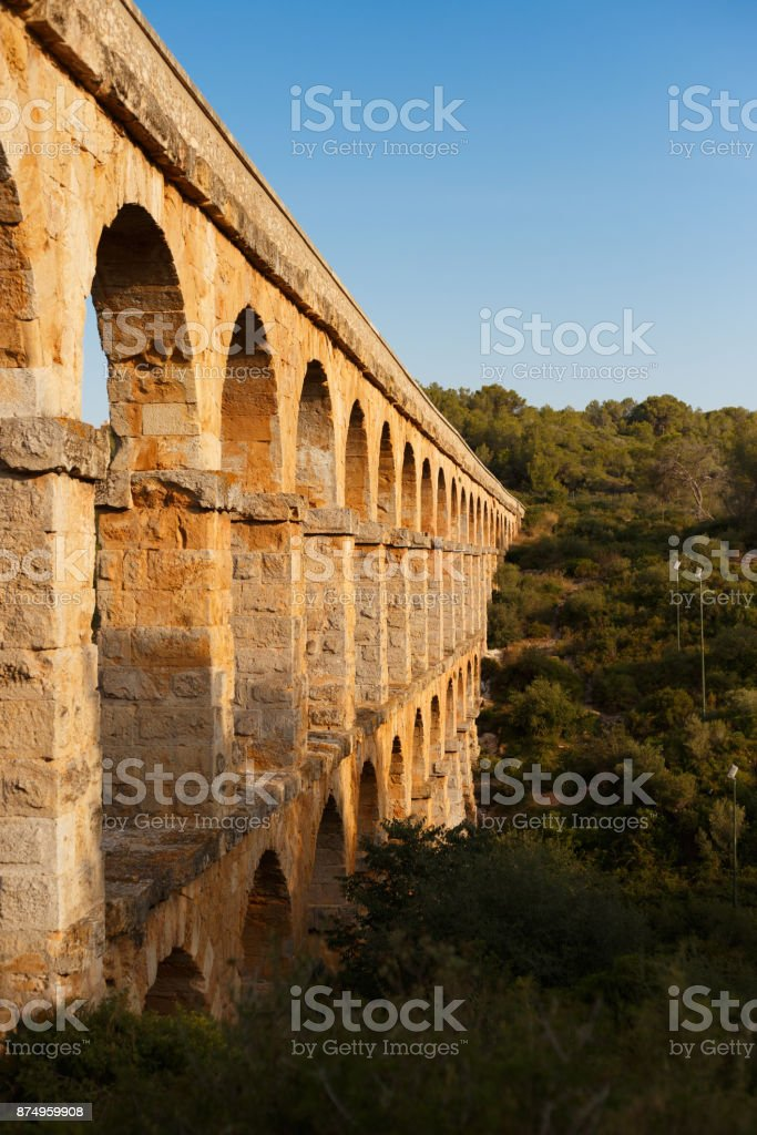 Beautiful view of roman Aqueduct Pont del Diable in Tarragona at sunset stock photo