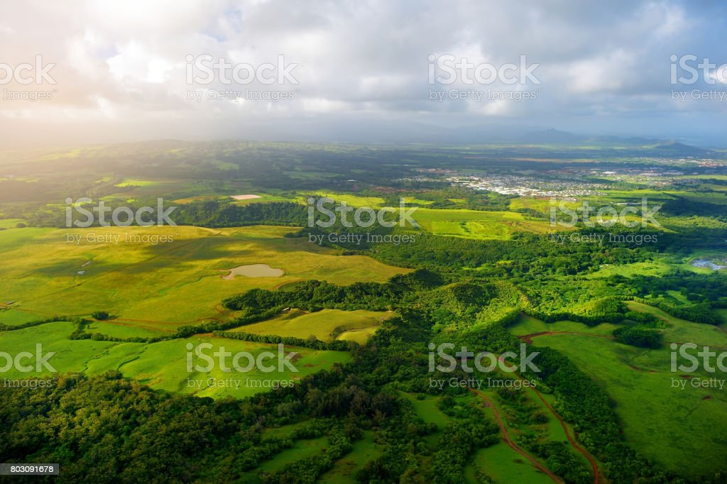 Beautiful view of spectacular jungles, field and meadows of Kauai island near Lihue town stock photo