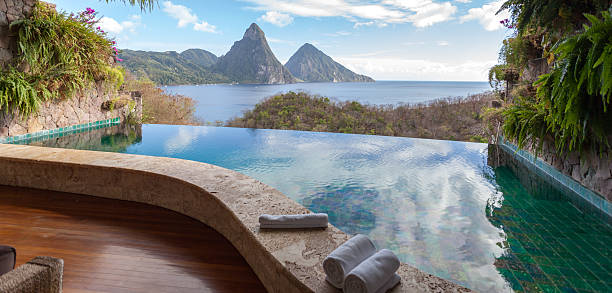 Beautiful view of St. Lucias Twin Pitons from Jade Mountain The World Heritage Petit Piton framed by  beautiful infinity-pool. View from the famous resort Jade Mountain. infinity pool stock pictures, royalty-free photos & images