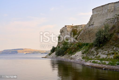 Amazing landscape with blue sky, steep cliffs and picturesque Bay. Natural panorama of rocks, textures. Beautiful summer view of Stepan Razin rock, Volga river, Saratov region, Russia. Tourism concept