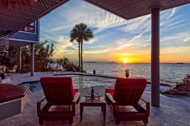 Beautiful view of swimming pool and Tampa Bay at sunset stock photo