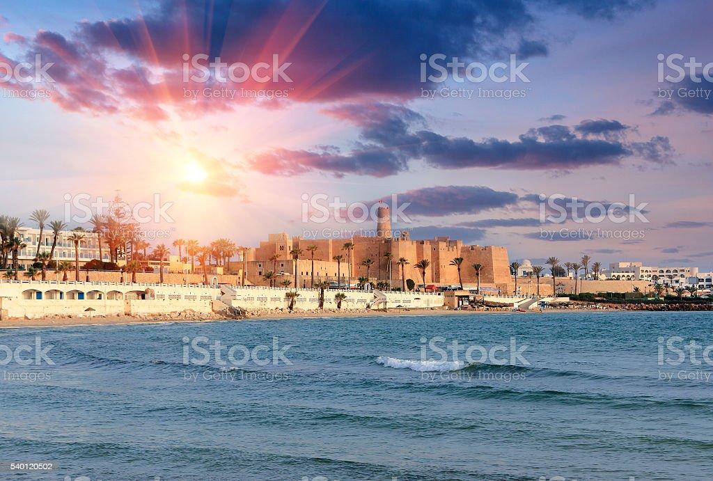 Beautiful view of the ancient Ribat fortress at sunset. Tunisia. stock photo