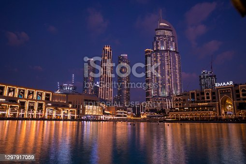 Dubai, UAE, 14 January 2021: Beautiful view of the Dubai Mall and the Dubai Fountain captured in the evening. The Dubai Mall is the largest mall in the world by total area