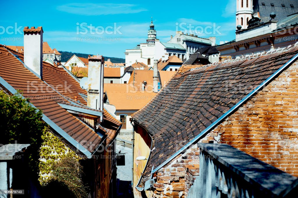 Beautiful view of the red rooftops with funnels against blue sky in Cesky Krumlov stock photo