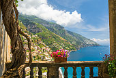 beautiful view of the town of Positano from antique terrace with flowers
