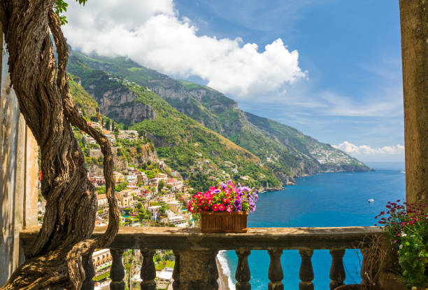 beautiful view of the town of Positano from antique terrace with flowers stock photo