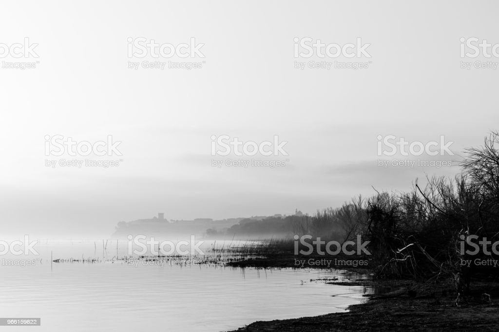 Beautiful view of Trasimeno  lake (Umbria) shore at dawn, with C - Royalty-free Autumn Stock Photo