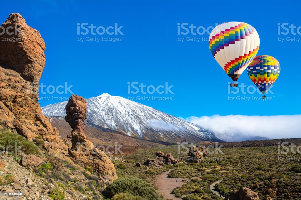 Beautiful view of unique Roque Cinchado unique rock formation with famous volcano Teide in the background on a sunny day, Teide National Park, Tenerife, Canary Islands, Spain stock photo