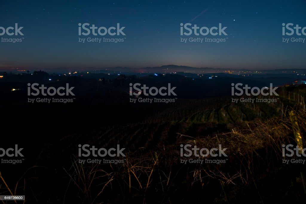 Beautiful view of vinery on hill during night stock photo