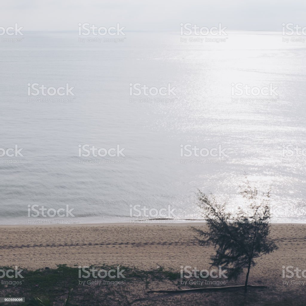 Beautiful view of white beach with blue sea before sunset background stock photo