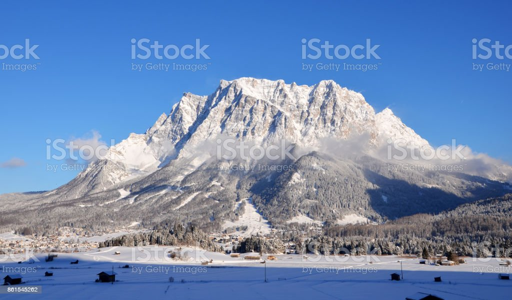 Beautiful view of Zugspitze in Germany on a sunny Winter Day, seen from Lermoos stock photo