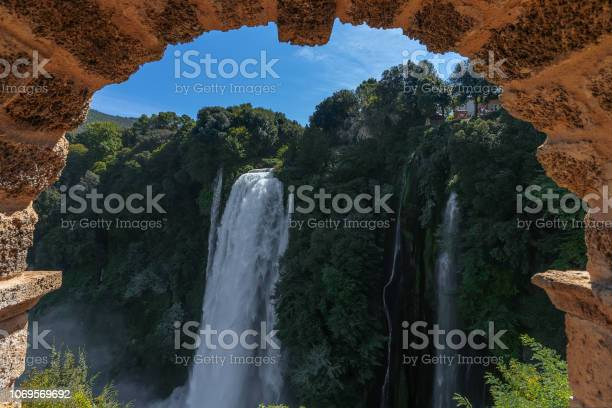 Photo of Beautiful view through the arch to the Marble waterfalls (Cascate delle Marmore), Umbria, Italy