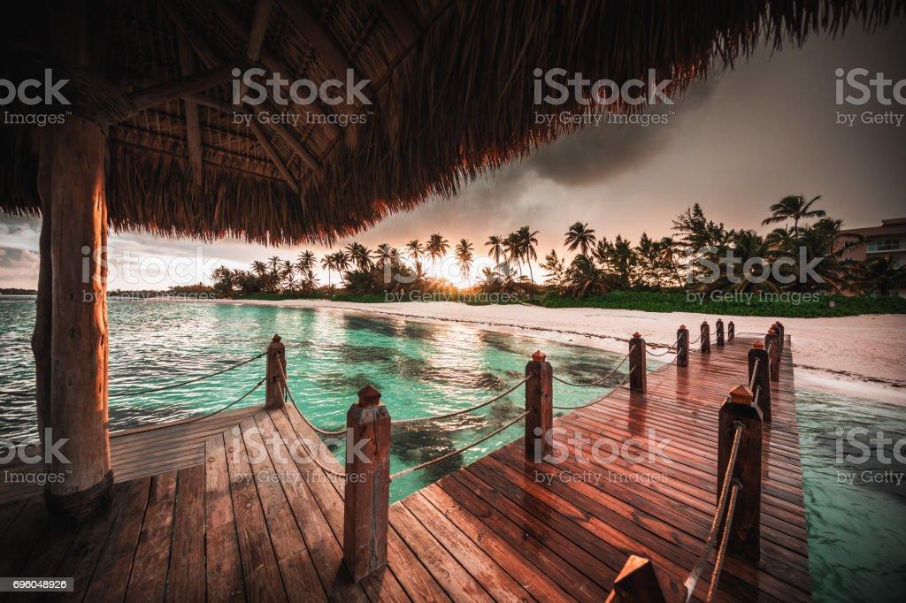 Beautiful view toward tropical beach and wooden water villa, Punta Cana stock photo