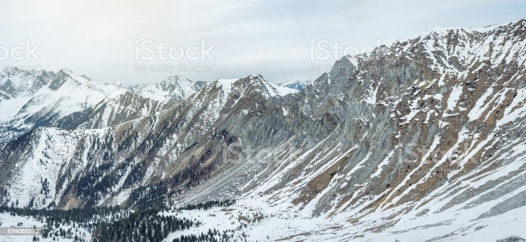 Beautiful views of the snowy peaks of the Baikal mountains at sunrise. Concept of travel and Hiking trips stock photo