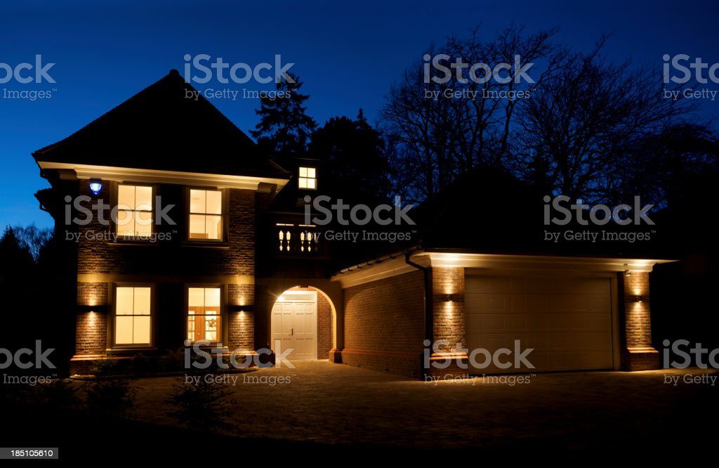 beautiful villa at dusk stock photo